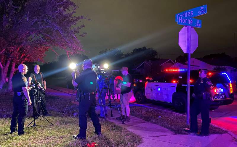 In this photo on Twitter released by the Fort Worth Police, Fort Worth Police Chief Neil Noakes holds a news briefing at the site of a shooting early Sunday, July 4, 2021, in Fort Worth, Texas. Multiple people were wounded early Sunday in a shooting near a Fort Worth car wash in which it appears multiple guns were used, police said. (Fort Worth Police Dept. via AP)