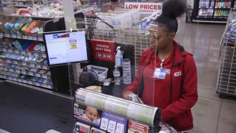 A sneeze guard is seen installed at a register in an H-E-B store in Houston on March 16, 2020.