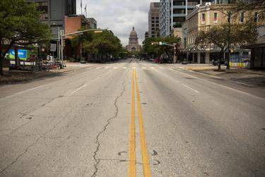 The streets in downtown Austin are mostly empty during the coronavirus pandemic.      Miguel Gutierrez Jr./The Texas Tribune