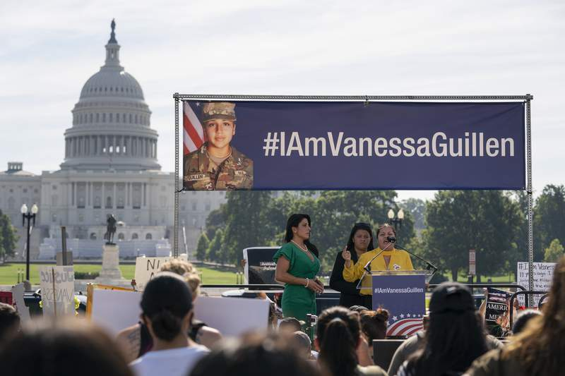FILE - In this July 30, 2020, file photo slain Army Spc. Vanessa Guillen's mother Gloria Guillen, right, joined by Vanessa's sister Lupe Guillen, center, and family attorney Natalie Khawam, speaks as she cries during a news conference on the National Mall in front of Capitol Hill in Washington. (AP Photo/Carolyn Kaster, File)