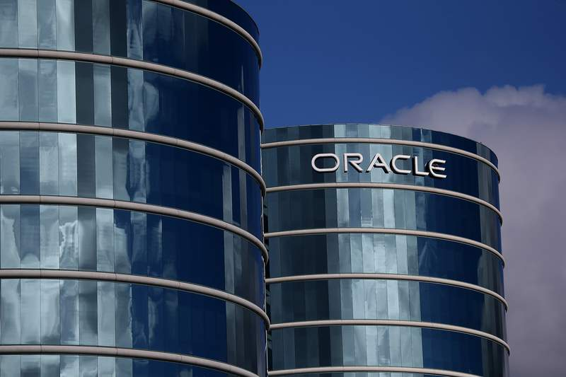 REDWOOD CITY, CA - DECEMBER 16:  The Oracle logo is displayed on the exterior of the Oracle headquarters on December 16, 2014 in Redwood City, California. Oracle will report second quarter earnings on Wednesday.  (Photo by Justin Sullivan/Getty Images)