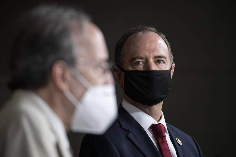 FILE - In this June 30, 2020, file photo Rep. Adam Schiff, D-Calif., Chairman of the House Intelligence Committee, right, listens as Rep. Eliot Engel, D-N.Y., Chairman of the House Committee on Foreign Affairs, speaks during a news conference on Capitol Hill, after a meeting at the White House in Washington. The House Foreign Affairs Committee has subpoenaed Secretary of State Mike Pompeo for documents he turned over to a Senate panel that is investigating Hunter Biden, the son of Democratic presidential candidate Joe Biden. Engel said Friday, July 31,  he had issued the subpoena as part an investigation into Pompeo's apparent use of Department of State resources to advance a political smear of former Vice President Joe Biden. (AP Photo/Alex Brandon, File)