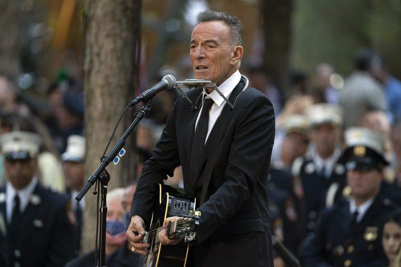 FILE - In this Saturday, Sept. 11, 2021, file photo, Bruce Springsteen performs during ceremonies to commemorate the 20th anniversary of the 9/11 terrorist attacks, at the National September 11 Memorial & Museum in New York. Springsteens most memorable artifacts including his favorite Fender guitar and stage outfits will be on display in a traveling interactive exhibit. The Grammy Museum announced Tuesday, Sept. 14, 2021, that Bruce Springsteen Live! will open at the Grammy Museum Experience in the Prudential Center in Newark, New Jersey, on Oct. 1. (AP Photo/John Minchillo, File)