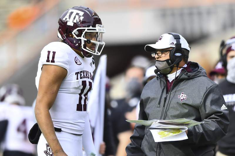 Texas A&M quarterback Kellen Mond (11) speaks to head coach Jimbo Fisher during an NCAA college football game against Tennessee in Neyland Stadium in Knoxville, Tenn., Saturday, Dec. 19, 2020. (Brianna Paciorka/Knoxville News Sentinel via AP, Pool)