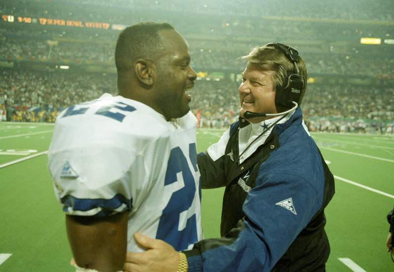 Dallas Cowboys' head coach Jimmy Johnson, right, talks with running back Emmitt Smith on the sidelines during the fourth quarter against the Buffalo Bills at the Super Bowl, Jan. 30, 1994, in Atlanta's Georgia Dome.  Smith was the Super Bowl's MVP as Dallas defeated the Bills, 30-13.  (AP Photo/Ron Heflin)