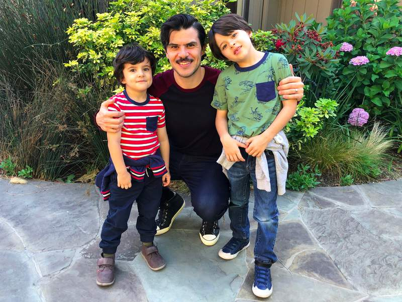 Juan Elias, shown here with (from left) sons Sebastian, 4, and Oliver, 7, has become their primary caregiver amid the coronavirus pandemic.