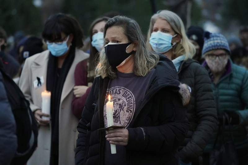 Mourners listen to speakers at a vigil for the 10 victims of the Monday massacre at a King Soopers grocery store late Thursday, March 25, 2021, at Fairview High School in Boulder, Colo. (AP Photo/David Zalubowski)
