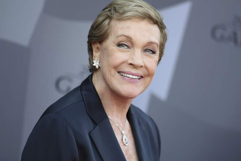 FILE - In this Sept. 29, 2015, file photo, actress Julie Andrews arrives at the Los Angeles Philharmonic 2015/2016 season opening gala at Walt Disney Concert Hall in Los Angeles. The American Film Institute says it is postponing its 48th annual AFI Life Achievement Award Gala Tribute honoring Andrews. The organization originally planned to give Andrews its Life Achievement Award on April 25, 2020, in Los Angeles. It will be rescheduled for early summer. (Photo by Richard Shotwell/Invision/AP, File)