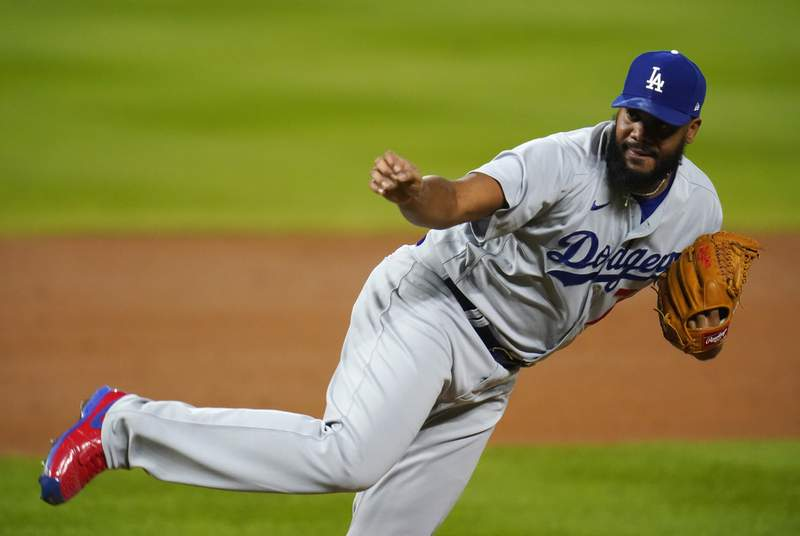 Los Angeles Dodgers relief pitcher Kenley Jansen works against the Colorado Rockies during the ninth inning of a baseball game Saturday, Sept. 19, 2020, in Denver. The Dodgers won 6-1. (AP Photo/David Zalubowski)