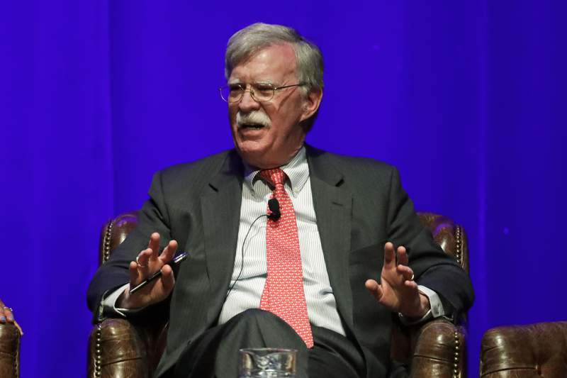 FILE - In this Feb. 19, 2020, file photo, former national security adviser John Bolton takes part in a discussion on global leadership at Vanderbilt University in Nashville, Tenn. An attorney for Bolton said Wednesday, June 10, that President Donald Trump is trying to put on ice publication of the former top administration officials forthcoming memoir after White House lawyers again this week raised concerns that the book contains classified material that presents a national security threat. (AP Photo/Mark Humphrey, File)