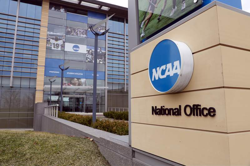 FILE - In this March 12, 2020, file photo, the national office of the NCAA in Indianapolis is shown. The NCAA Board of Directors is expected to greenlight one of the biggest changes in the history of college athletics when it clears the way for athletes to start earning money based on their fame and celebrity without fear of endangering their eligibility or putting their school in jeopardy of violating amateurism rules that have stood for decades. (AP Photo/Michael Conroy, File)