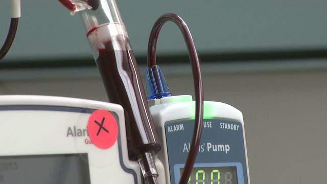 Blood moves through a pump as a person donates blood at a Houston bank Dec. 10, 2018.