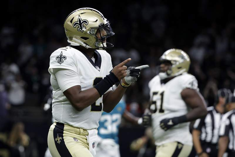 New Orleans Saints quarterback Jameis Winston (2) reacts after throwing a touchdown pass in the first half of an NFL preseason football game against the Jacksonville Jaguars in New Orleans, Monday, Aug. 23, 2021. (AP Photo/Derick Hingle)