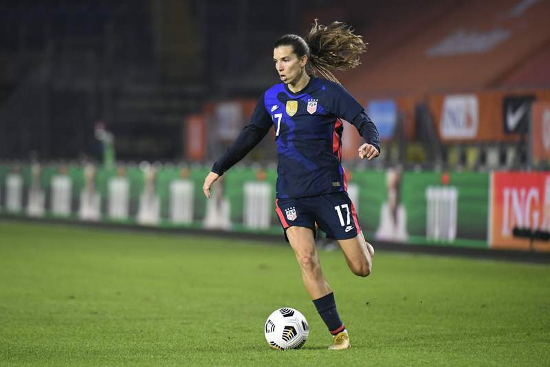 FILE - In this Friday Nov. 27, 2020 file photo, United States' Tobin Heath plays the ball during their international friendly women's soccer match against The Netherlands at the Rat Verlegh stadium in Breda, Netherlands. United States international Tobin Heath is staying in English soccer. The 33-year-old forward has signed for Arsenal in the Womens Super League on Friday, Sept. 3, 2021. She played at Manchester United last season. (Piroschka van de Wouw/Pool via AP, file)