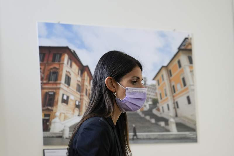 Rome Mayor Virginia Raggi arrives for a meeting at the Rome's Foreign Press association offices, Thursday, Sept. 16, 2021. After five years in office as Romes first populist mayor, Virginia Raggi is running for a second term in the citys Oct. 3-4 election.  (AP Photo/Alessandra Tarantino)