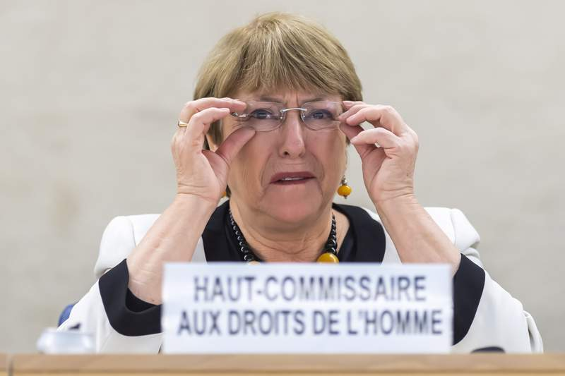 UN High Commissioner for Human Rights Michelle Bachelet speaks an update on the situation of human rights in Venezuela, of the Human Rights Council, at the European headquarters of the United Nations in Geneva, Switzerland, Wednesday, Dec. 18, 2019. (KEYSTONE/Martial Trezzini)/Keystone via AP)