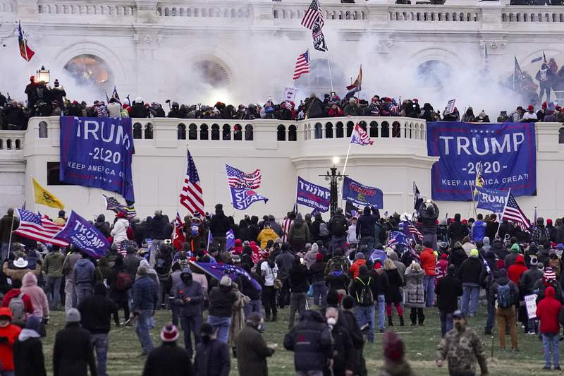 FILE - In this Jan. 6, 2021, file photo, rioters supporting President Donald Trump storm the Capitol in Washington. The House is poised to launch a new investigation of the Jan. 6 Capitol insurrection on Wednesday, Jan. 30, with expected approval of a 13-person select committee to probe the violent attack. (AP Photo/John Minchillo, File)