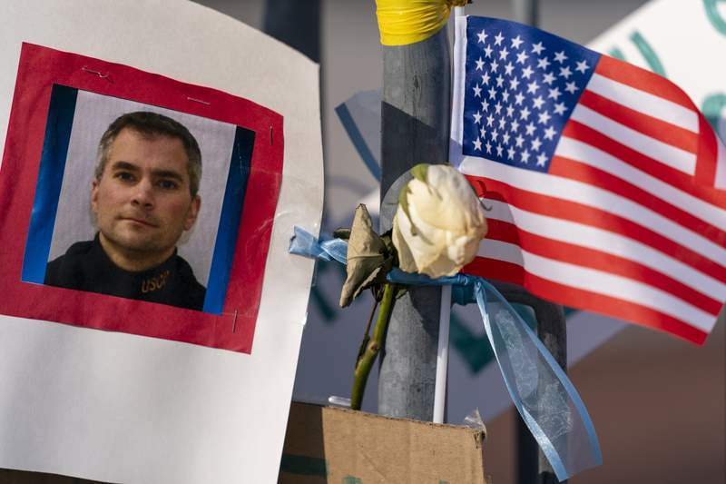 A memorial for U.S. Capitol Police officer Brian D. Sicknick is visible near the U.S. Capitol building on Capitol Hill in Washington, Thursday, Jan. 14, 2021. Officer Sicknick was killed by rioters in last Wednesday's attack on the Capitol Building. (AP Photo/Andrew Harnik)