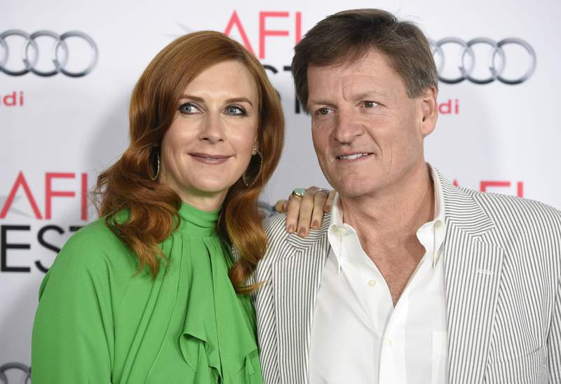 """FILE - In this Thursday, Nov. 12, 2015, file photo, Tabitha Soren, left, and Michael Lewis arrive at the world premiere of """"The Big Short"""" during the AFI Fest at the TCL Chinese Theatre, in Los Angeles. The 19-year-old daughter of Moneyball author Lewis and former MTV correspondent Soren was killed in a Northern California highway crash, according to her family and authorities. Dixie Lewis was a passenger in a car driven by her friend and former Berkeley High School classmate, Ross Schultz, 20, who also died in the Tuesday afternoon, May 25, 2021, accident. (Photo by Chris Pizzello/Invision/AP, File)"""