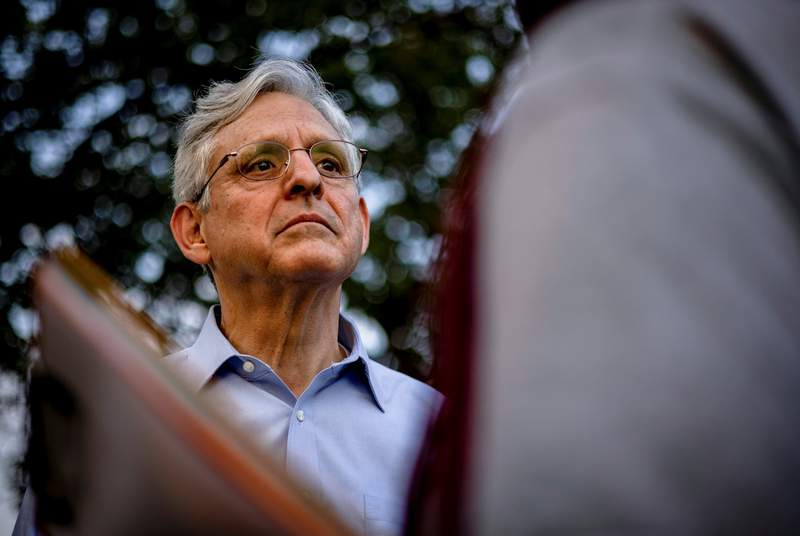 U.S. Attorney General Merrick Garland listened to community leaders while visiting youth baseball games held by the Chicago Westside Sports at Columbus Park on July 22, 2021.