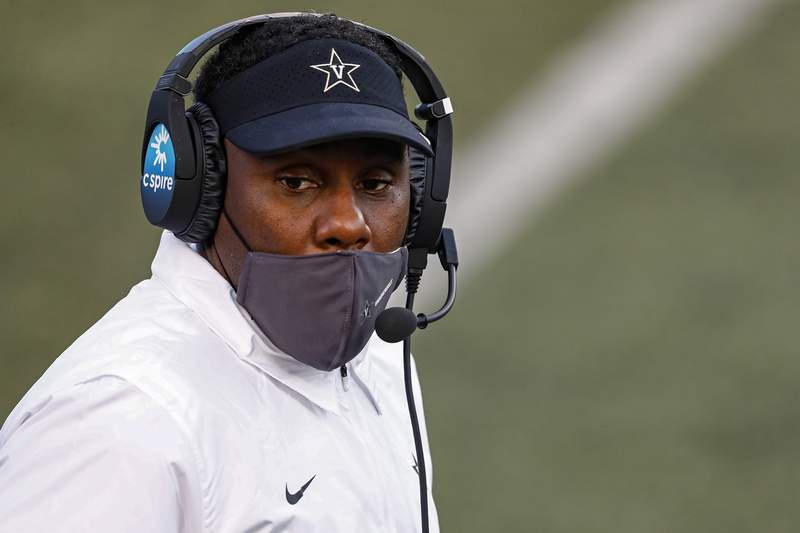 FILE - In this Oct. 31, 2020, file photo, Vanderbilt head coach Derek Mason looks on from the sideline during an NCAA college football game against Mississippi in Nashville, Tenn. Vanderbilt women's soccer goalkeeper Sarah Fuller has practiced with the football team, and coach Derek Mason says she's an option at kicker Saturday against Missouri. (AP Photo/Wade Payne, File)