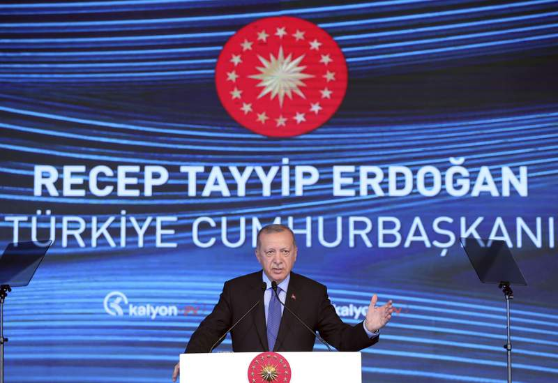 Turkey's President Recep Tayyip Erdogan speaks during the inauguration of a solar technologies plant, outside Ankara, Turkey, Wednesday, Aug. 19, 2020. Erdogan said that Turkey will defend its rights in the eastern Mediterranean until the end, but Ankara wants Greece to take steps paving the way for dialogue.(Turkish Presidency via AP, Pool)