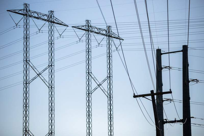 Electrical power lines near the Sand Hill Energy Center in Dell Valle on March 24, 2020.