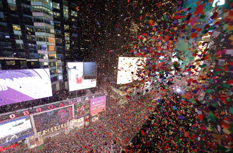 Confetti fills the air over top of revelers during New Year's Eve celebrations in Times Square on January 1, 2020 in New York City. (Photo by Gary Hershorn/Getty Images)