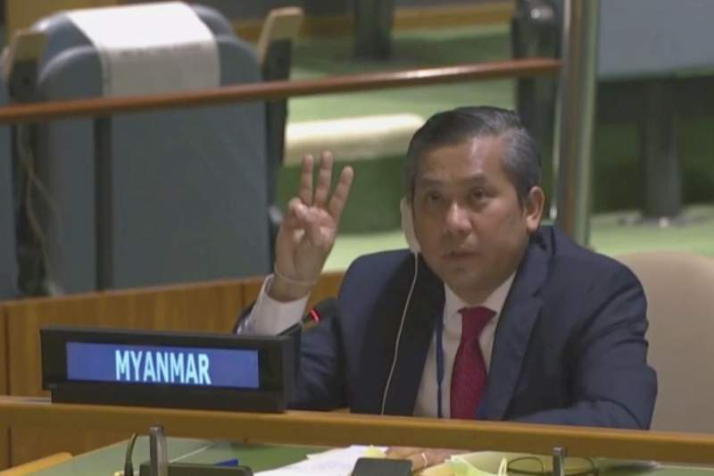 In this image taken from video by UNTV, Myanmar Ambassador to the United Nations Kyaw Moe Tun flashes the three-fingered salute, a gesture of defiance done by anti-coup protesters in Myanmar, at the end of his speech before the U.N. General Assembly at the United Nations Friday, Feb. 27 , 2021. Myanmars U.N. ambassador strongly opposed the military coup in his country and appealed for the strongest possible action from the international community to immediately restore democracy in a dramatic speech to the U.N. General Assembly Friday that drew loud applause from many diplomats in the 193-nation global body. (UNTV via AP)