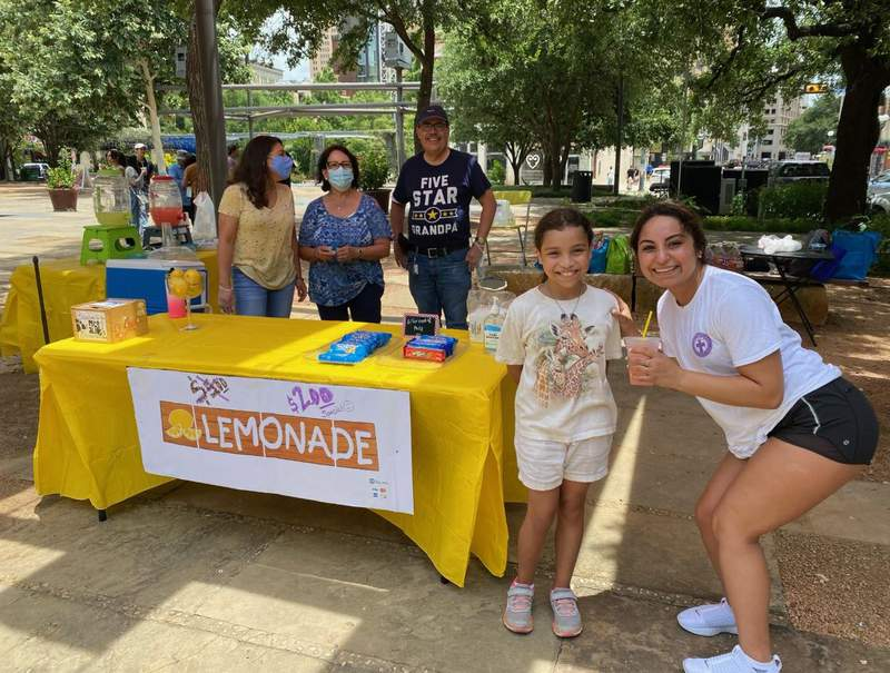 """Sofia Ortiz had her stand, called """"Animals' Saving Lemonade,"""" set up at Main Plaza, in front of the San Fernando Cathedral on Sunday."""