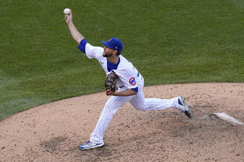 Chicago Cubs relief pitcher Ryan Tepera throws to the Miami Marlins in the eighth inning of Game 1 of a National League wild-card baseball series in Chicago, Wednesday, Sept. 30, 2020. (AP Photo/Nam Y. Huh)
