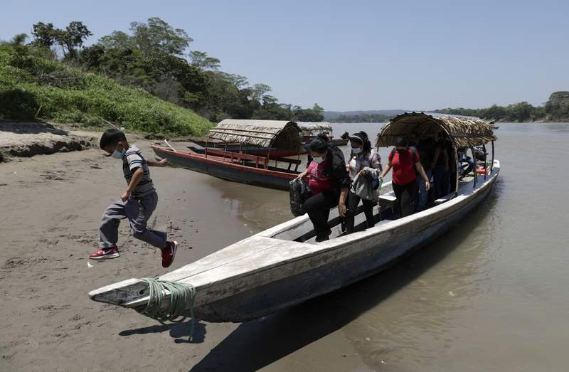 Migrants disembark on the Mexican side of the border after crossing the Usumacinta River from Guatemala, in Frontera Corozal, Chiapas state, Mexico, Wednesday, March 24, 2021. (AP Photo/Eduardo Verdugo)