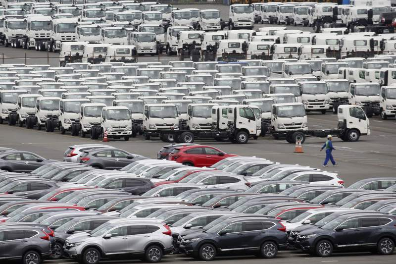 FILE - In this July 8, 2019, file photo, cars wait to be exported at Yokohama port, near Tokyo. Japan's Finance Ministry says the nation recorded a trade deficit for the month of January, as exports continued to decline amid worries about the spread of a new virus that could deaden regional economic growth. The ministry said in a report Wednesday, Feb.  19, 2020, that the trade deficit for last month totaled 1.3 trillion yen, or $12 billion. That marked the third straight month of a trade deficit for the world's third largest economy. (AP Photo/Koji Sasahara, File)