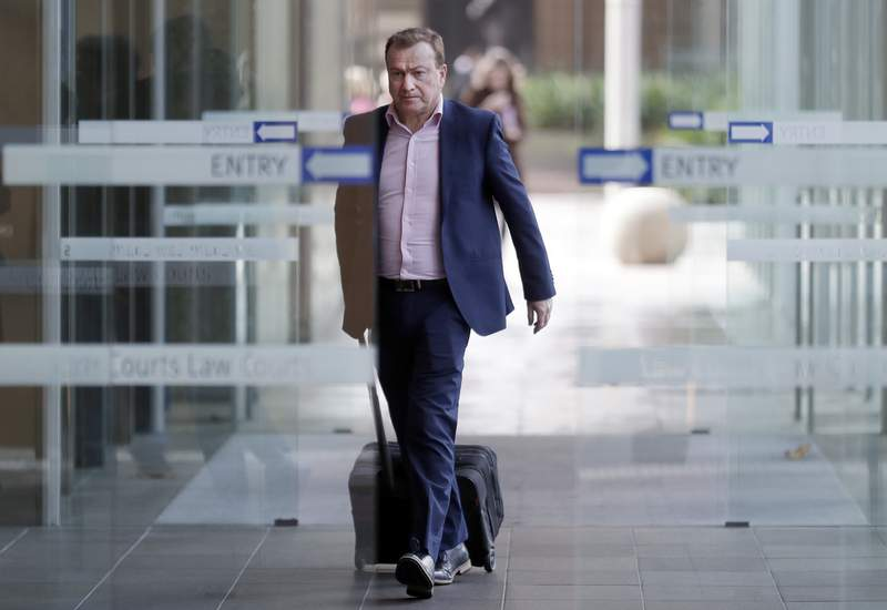 FILE - In this May 6, 2021, file photo, Andrew Cooper, founder and president of libertarian group LibertyWorks, arrives at Federal Court in Sydney. An Australian court on Tuesday, June 1, 2021, has rejected a challenge to the federal government's draconian power to prevent most citizens from leaving the country so that they don't bring COVID-19 home. (AP Photo/Rick Rycroft, File)