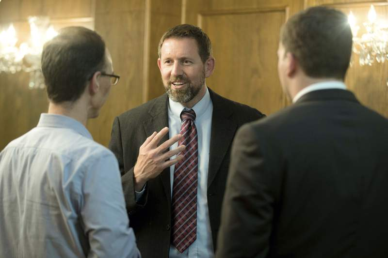 FILE - In this Sept. 23, 2014, file photo, former Montana Solicitor General Lawrence VanDyke, center, talks with law students Jason Collins, left, and Tyler Dugger before a Montana Supreme Court candidate forum at the University of Montana in Missoula, Mont. The Senate has confirmed VanDyke as a federal appeals court judge despite a not qualified rating from the American Bar Association and sharp opposition from his home-state senators. (AP Photo/Lido Vizzutti, File)