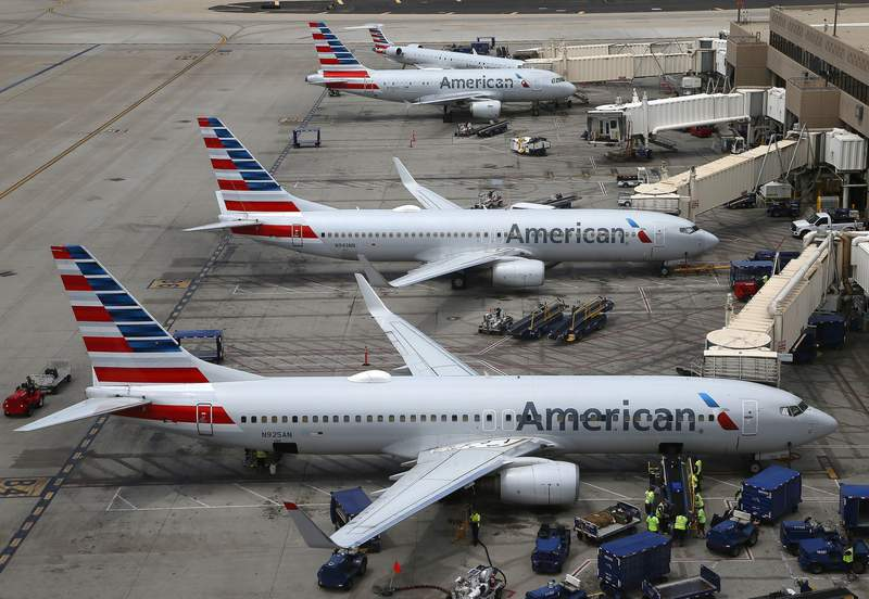 FILE - In this July 17, 2019 file photo American Airlines planes are parked on the tarmac at Phoenix Sky Harbor International Airport in Phoenix. American Airlines Group Inc. (AAL) on Thursday, April 22, 2021, reported a loss of $1.25 billion in its first quarter. (AP Photo/Ross D. Franklin, File)