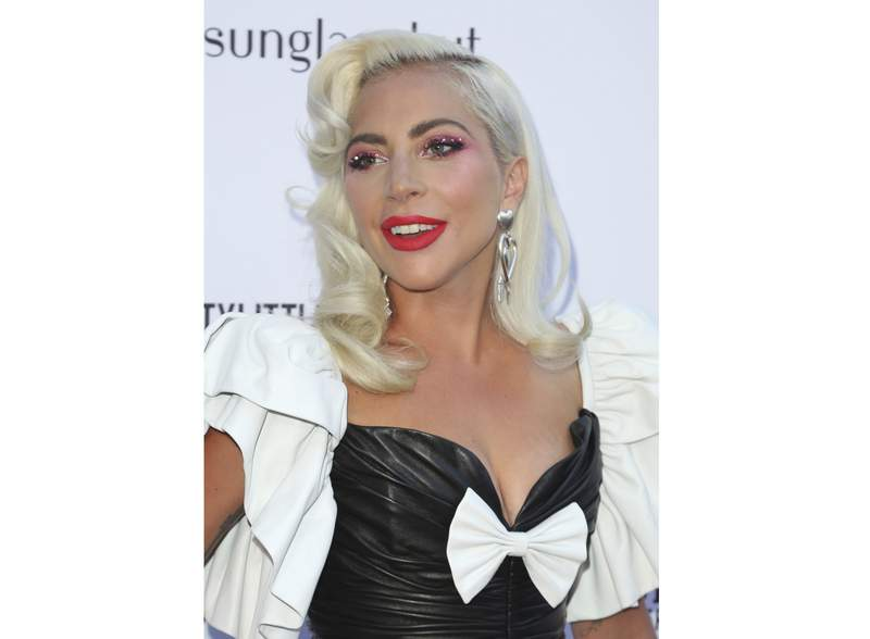 FILE - This March 17, 2019 file photo shows Lady Gaga at the 2019 Daily Front Row's Fashion Los Angeles Awards in Beverly Hills, Calif. Gaga and advocacy organization Global Citizen have raised millions to fight the coronavirus and will launch a TV special featuring Paul McCartney, Stevie Wonder and Billie Eilish to combat the growing virus. Gaga said on Monday that the money was raised in seven days and will benefit The World Health Organization. (Photo by Willy Sanjuan/Invision/AP, File)