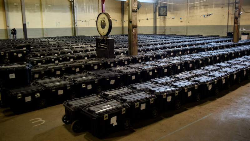 Election precinct suitcases containing ballots, election materials and keys to voting machines are held under guard by the Allegheny County Police at the Allegheny County elections warehouse on November 4, 2020 in Pittsburgh, Pennsylvania. Photo by Jeff Swensen