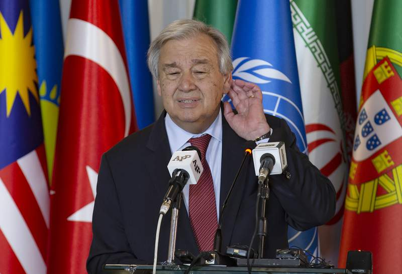 FILE - In this Feb. 16, 2020, file photo, U.N. Secretary-General Antonio Guterres listens to a reporter during a joint news conference in Islamabad, Pakistan. Guterres on Thursday, Sept. 3, 2020, has urged Japan and other wealthy nations to give up their reliance on coal and other fossil fuels and commit to investments in green energy as they recover from the coronavirus pandemic. (AP Photo/B.K. Bangash, File)