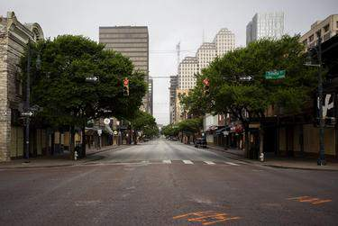An empty Sixth Street during morning rush hour in Downtown Austin. The city's streets were mostly empty as a result of the coronavirus pandemic in Texas. March 25, 2020. (Miguel Gutierrez Jr./The Texas Tribune)