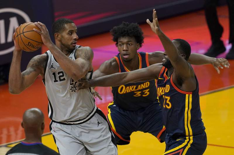 San Antonio Spurs center LaMarcus Aldridge (12) is defended by Golden State Warriors center James Wiseman, middle, and forward Draymond Green during the first half of an NBA basketball game in San Francisco, Wednesday, Jan. 20, 2021.