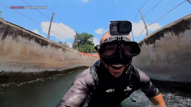(Image of Brandon Jordan diving in Comal River.)