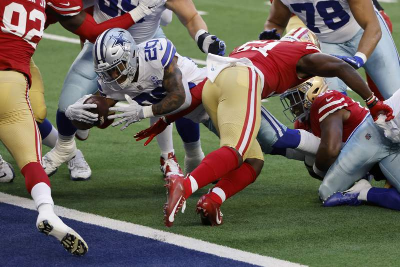 Dallas Cowboys running back Tony Pollard (20) breaks through tackle attempt to reach the end zone for a touchdown in the first half of an NFL football game against the San Francisco 49ers in Arlington, Texas, Sunday, Dec. 20, 2020. (AP Photo/Ron Jenkins)