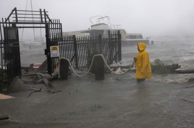 Jame Rowles examines the damage after the docks at the marina where his boat was secured were destroyed as Hurricane Hanna made landfall, Saturday, July 25, 2020, in Corpus Christi, Texas. (AP Photo/Eric Gay)