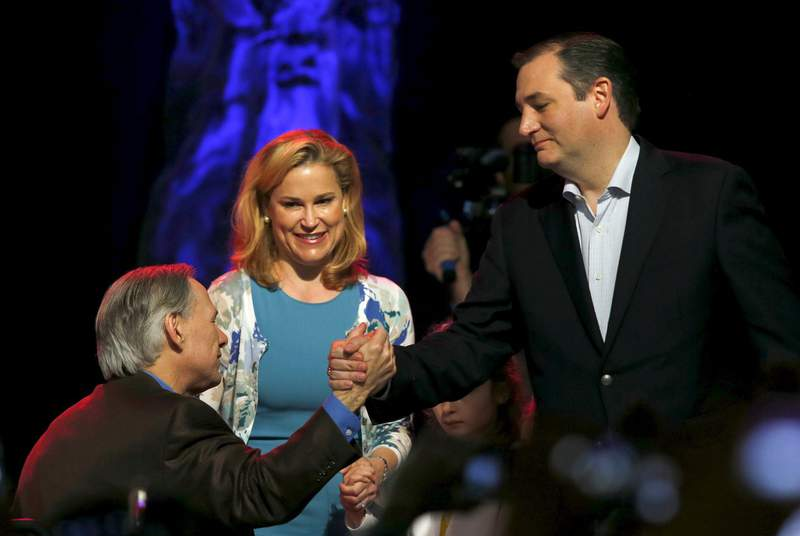 Governor Greg Abbott shook hands with then-U.S. Republican presidential candidate Ted Cruz as Cruz's wife Heidi Cruz looked on at a campaign rally in Dallas on Feb. 29, 2016.