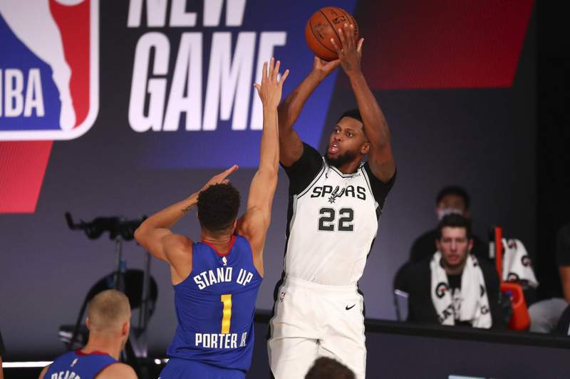 San Antonio Spurs forward Rudy Gay (22) shoots against Denver Nuggets forward Michael Porter Jr. (1) during the first half of an NBA basketball game Wednesday, Aug. 5, 2020, in Lake Buena Vista, Fla.