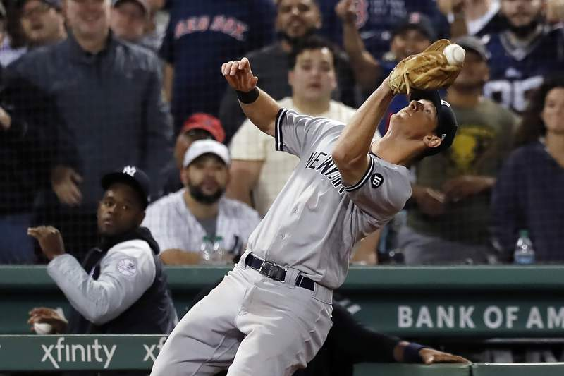 New York Yankees' DJ LeMahieu misses the catch on a pop foul by Boston Red Sox's Kyle Schwarber during the seventh inning of a baseball game, Sunday, Sept. 26, 2021, in Boston. (AP Photo/Michael Dwyer)