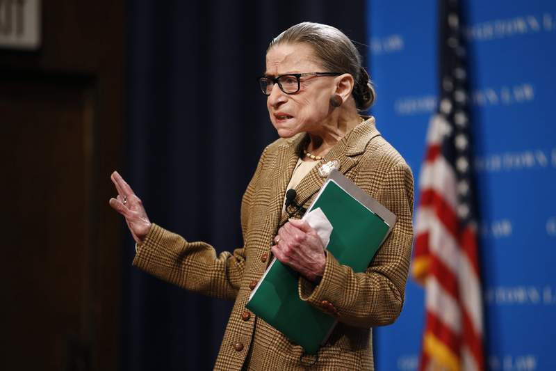 U.S. Supreme Court Associate Justice Ruth Bader Ginsburg acknowledges the crowd as she arrives to speak at a discussion on the 100th anniversary of the ratification of the 19th Amendment at Georgetown University Law Center in Washington, Monday, Feb. 10, 2020. (AP Photo/Patrick Semansky)