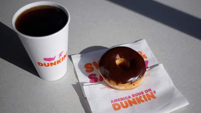Dunkin' Donuts coffee and donut. (Luke Sharrett/Bloomberg via Getty Images)