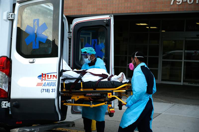 A patient is transferred from  Elmhurst Hospital  in New York, US, on April 25, 2020. Elmhurst Hospital Trauma Center In Queens Borough of New York City Continues Receiving Covid-19 Patients. While hospitals in New York City have been overwhelmed by the number of Covid -19 cases, currently they are experiencing a downturn in daily patient intakes as the statistical curve has flattened and it is in a downturn. New York City has reached over 17,000 deaths and over 57,000 hospitalizations were reported in the state of NY to date. (Photo by John Lamparski/NurPhoto via Getty Images)